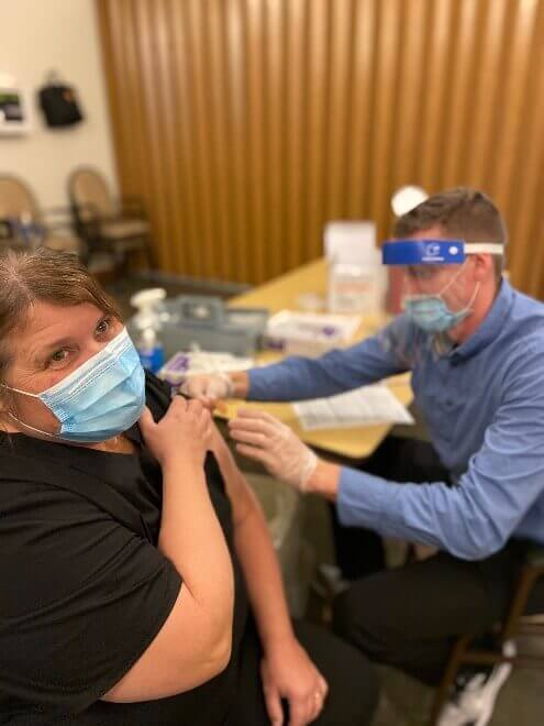 Diana Sobolik, co-director of nursing, as she received her second covid-19 vaccination